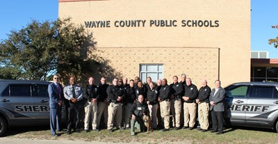 Dr. Dunsmore and Sheriff Pierce standing with WCSO SROs and supervisor support.