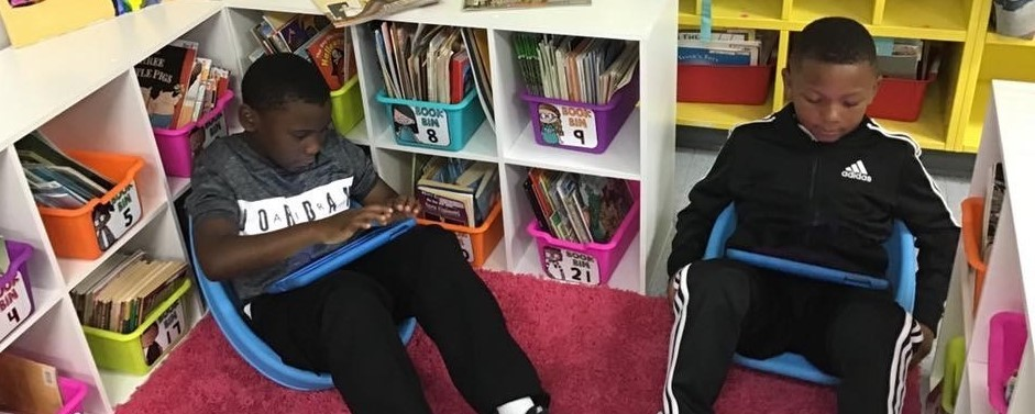 2nd grade students working on iPads