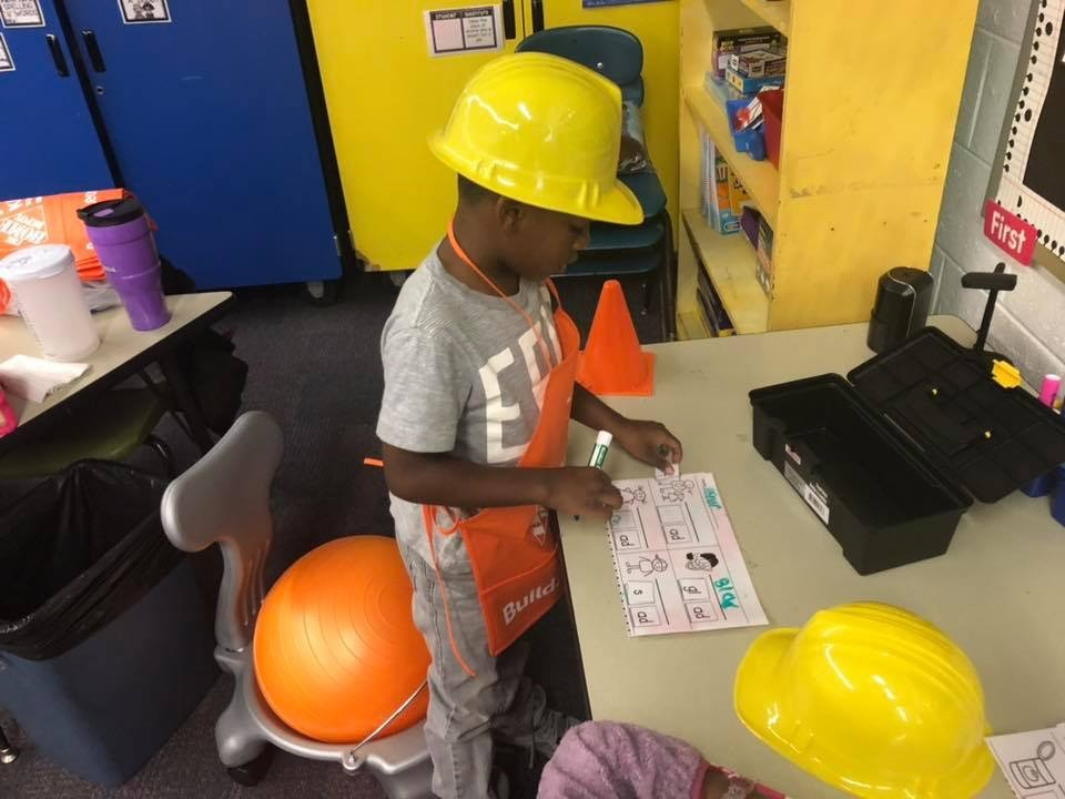 1st grade student building his reading skills