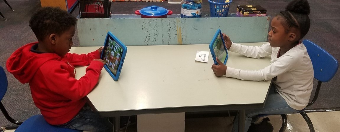 Students enjoying working on the iPads.