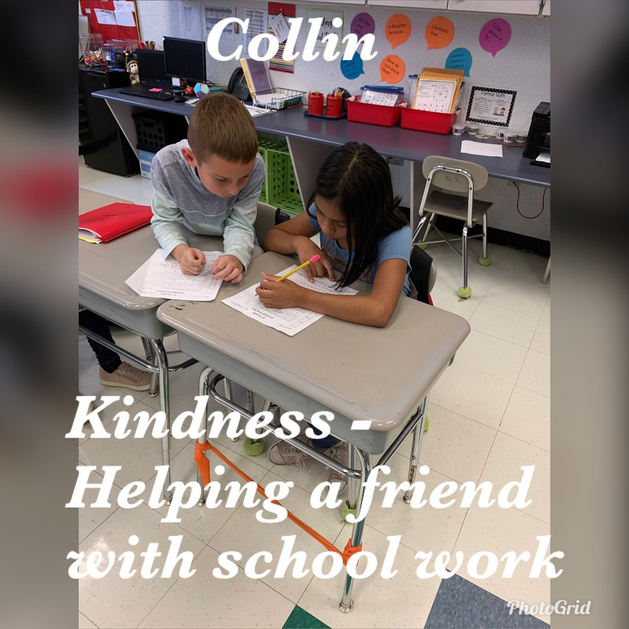 3rd grade student helping another student in the classroom!