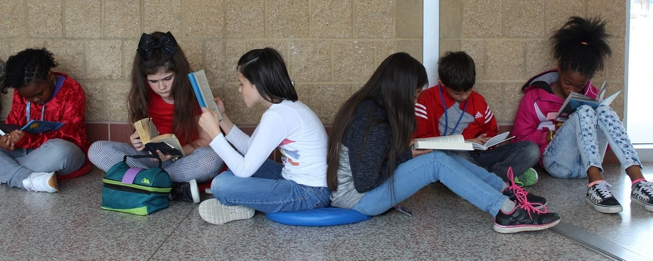 Students reading in hall