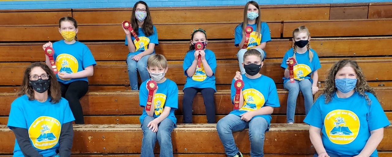 Battle of the Books team celebrating their 2nd place ribbons
