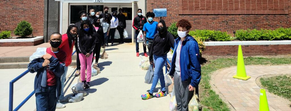 students outside school building