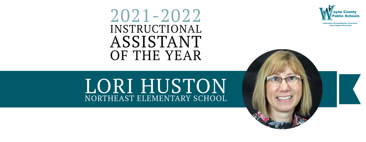 Banner of Instructional Assistant of the Year, Lori Huston, Northeast Elementary School