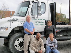 People in front of a semi truck